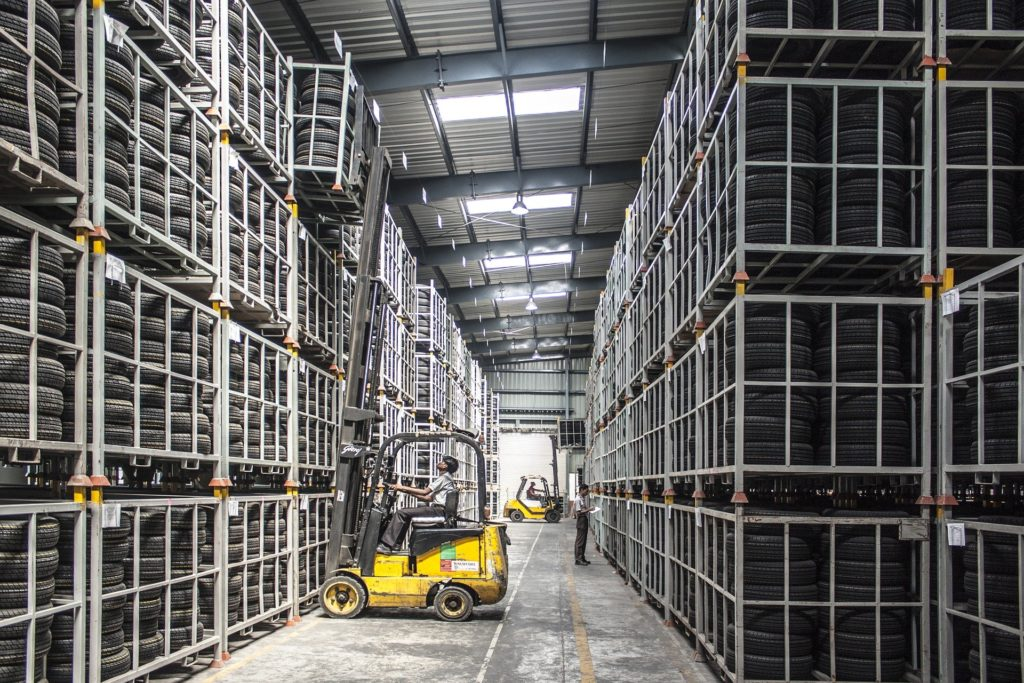 forklift in a warehouse with tires