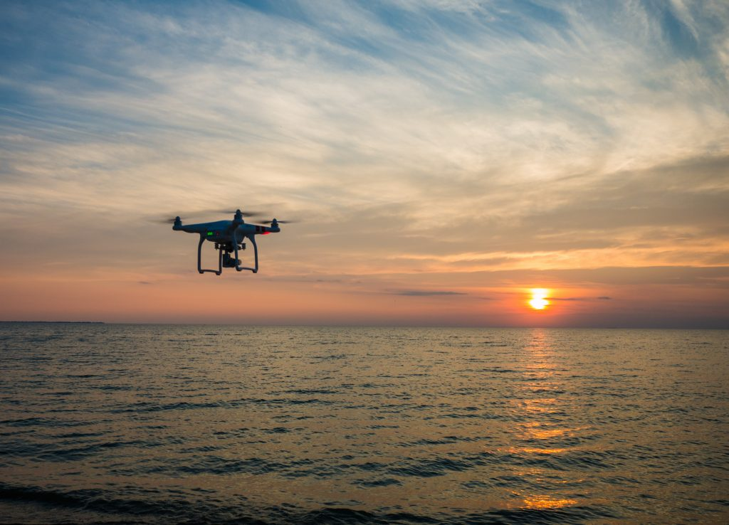 Drone flying over body of water-how.fm-last mile delivery